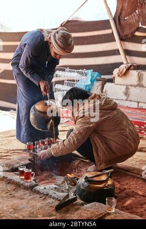 Serving tea in traditional bedouin camp, Wadi Rum desert, Aqaba, Jordan - Stock Photo
