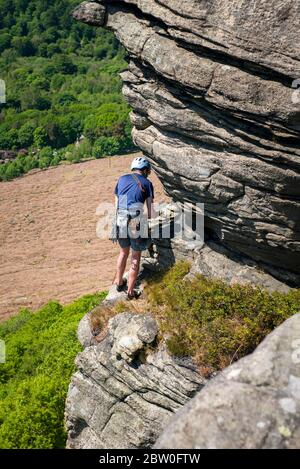 Man climbing on Bamford Edge, UK, Peak District - Stock Photo