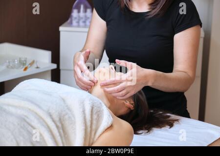 Professional facial massage, spa, beauty, face concept