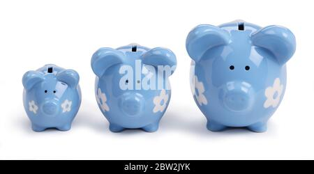 Small medium and large piggy banks - Stock Photo