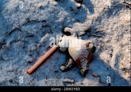 Abandoned or lost toy lies on the snow. Concept of loneliness, depression and death