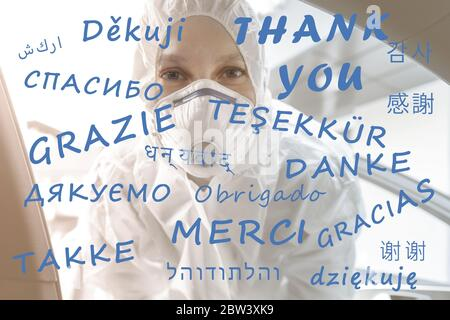 Thank you text on different world global languages with tired female nurse doctor or medical worker in ppe facemask on background. Gratitude to all - Stock Photo