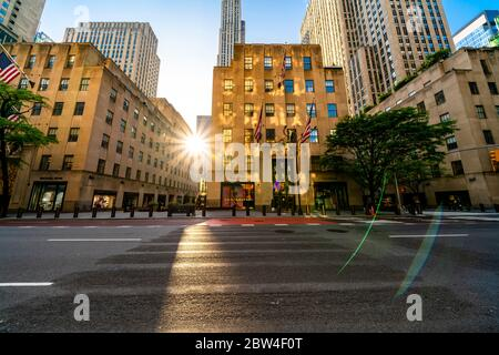 People and traffic extremely decreased from Midtown Fifth Avenue in the dusk for impact of COVID-19 at New York City NY USA on May 25 2020.