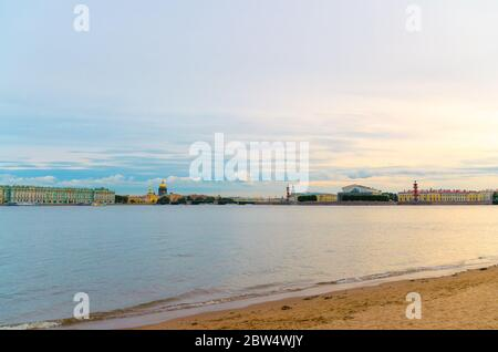 Sandy beach of Zayachy Hare Island, Neva river, cityscape of Saint Petersburg Leningrad city with Winter Palace, State Hermitage Museum, Saint Isaac's Cathedral, Arrow of Vasilyevsky Island, Russia - Stock Photo