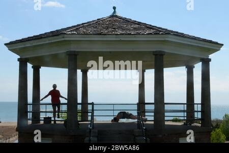 Racine, Wisconsin, USA. 29th May, 2020. EMMA MADDEN, left, and CARLIE GLENN come to the gazebo above North Beach on the Lake Michigan shoreline in Racine, Wisconsin to exercise Friday May 28, 2020. The area is having its first sustained stretch of seasonably warm weather. Credit: Mark Hertzberg/ZUMA Wire/Alamy Live News - Stock Photo