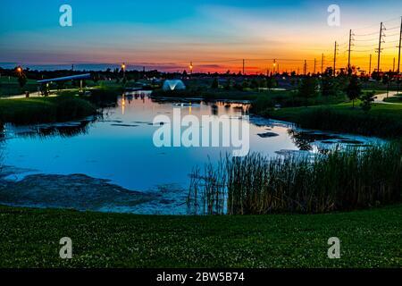 Sunset over Mercy Park in Joplin, Missouri - Stock Photo