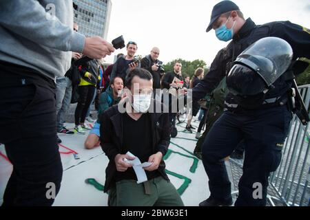 Ljubljana, Slovenia. 29th May, 2020. Protesters are being arrested by police officers during an anti-government protest.Every Friday, thousands of people in Ljubljana protest against the government of Prime Minister Janez Janša amid allegations of his government's corruption and undemocratic rule. Credit: SOPA Images Limited/Alamy Live News - Stock Photo