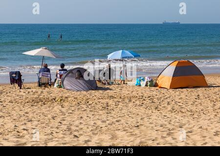 Bournemouth, Dorset UK. 30th May 2020. UK weather: hot sunny day at Bournemouth beaches as the glorious weather continues and temperatures rise with clear blue skies and unbroken sunshine. Sunseekers head to the seaside early to get a good spot and enjoy the sunshine, as the beaches are expected to get packed later. Credit: Carolyn Jenkins/Alamy Live News - Stock Photo