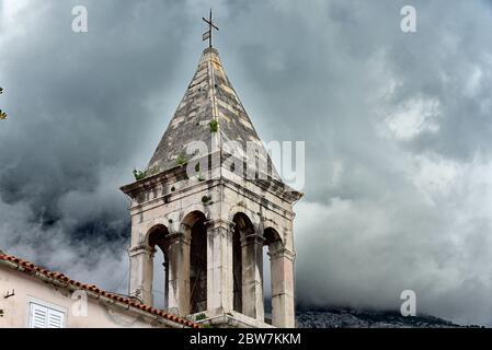 The bell tower of main church in famous and beautiful Makarska town in Dalmatia popular tourist destination in Dalmatia. Croatia - Stock Photo