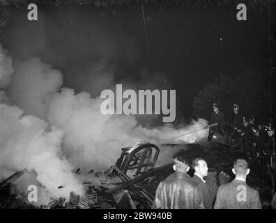A fire at the motor car wreckers and builders yard in Bexley , London . 1938 - Stock Photo