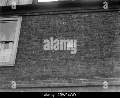 A fire plaque on a building . 1937 - Stock Photo