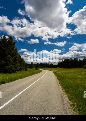 Countryside countryroad sunshine with numerous Spring clouds Sunger in Croatia Europe