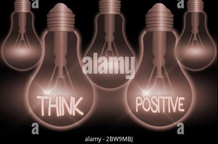Writing note showing Think Positive. Business concept for creating thoughts that encourage and help recharge an individual - Stock Photo