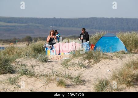 Poole, UK. 31st May 2020.    The Early birds  setting up for the day at Sandbanks beach, Poole, Dorset Credit: Richard Crease/Alamy Live News - Stock Photo