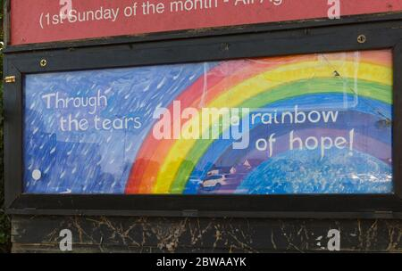 Poole, Dorset UK. 31st May 2020. Through the tears a rainbow of hope sign at St Aldhelm's Church, Branksome, Poole - positive message during Coronavirus Covid 19 pandemic lockdown. Credit: Carolyn Jenkins/Alamy Live News - Stock Photo