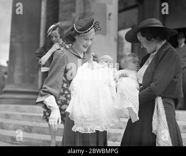 A double christening at All Souls Church , Langham Place , London . The Countess of Craven ( left ) , the former Miss Irene Meyrick , with her baby daughter , Lady Sarah Jane Craven and her sister , Mrs J Dearman with her son , Glyn John . 4 July 1940 - Stock Photo