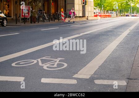 View of bicycle icon symbol on bicycle lane on the road of downtown in Düsseldorf, Germany. Cycling friendly city in Europe. - Stock Photo