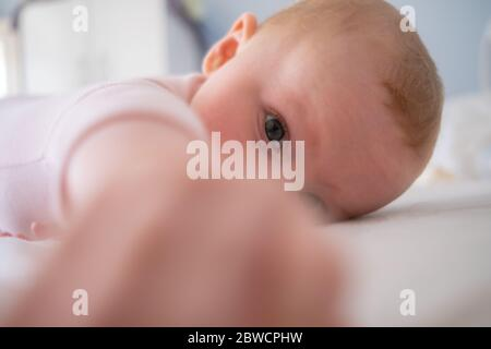Cute baby girl standing on bed make funny faces, angry face, crying in the morning