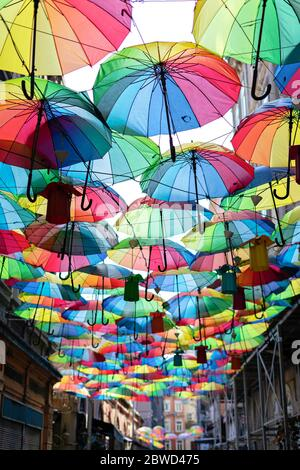 Background colorful rainbow different color umbrellas. unban tourist street decoration. Istanbul, Karakoy - Stock Photo