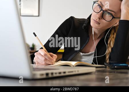 tired business woman working online or study education using laptop note pad, Remote working. Online teacher or Coach