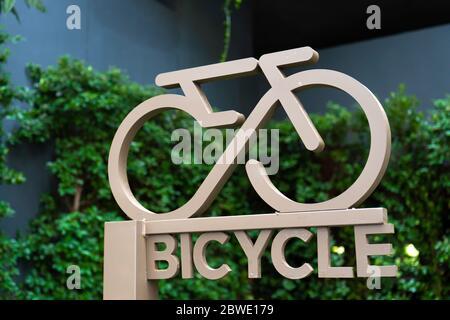 Close-up Yellow Stylish Bicycle Parking Sign close up. - Stock Photo