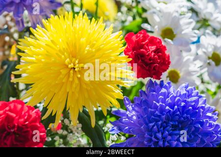Many bright and beautiful flowers collected in a large bouquet - Stock Photo
