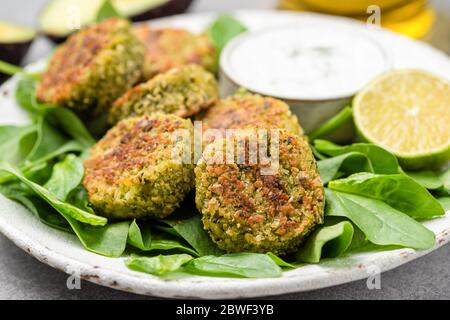 Vegetarian Spinach Falafel Fritters On Plate Closeup View - Stock Photo
