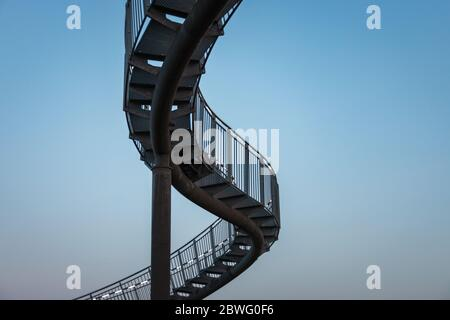 Duisburg, Germany – August 28, 2018: Fragment of walkable Tiger & Turtle roller coaster sculpture on Magic Mountain. The construction is an illuminate Stock Photo