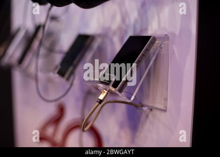 Moscow, Russia - OctobMoscow, Russia - October 04, 2019: mp3 player sony Walkman NW-A100 SERIES gray lies in a stand attached to the wall, soft focus - Stock Photo