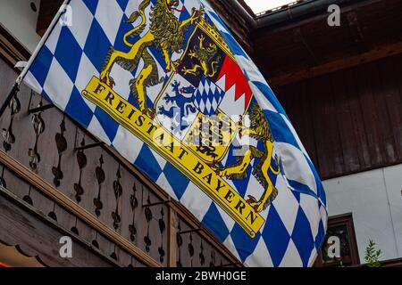 Bavarian flag waving in the wind - OBERAMMERGAU, GERMANY - MAY 27, 2020 - Stock Photo