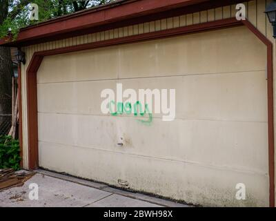 Oak Park, Illinois. 1st June 2020. Racist graffiti tagged on a garage on the north side of this Chicago suburb. Evidently, the purpetrators knew who lived on each tagged property as both anti-white and anti-black graffiti was used on selected properties and varied with the race of the homeowners. tagged on a garage on the north side of this Chicago suburb. - Stock Photo