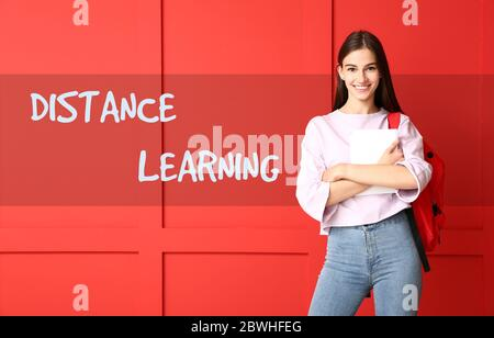 Beautiful female student on color background. Concept of distance learning - Stock Photo