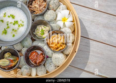 Different various kinds of dim sum including dumplings traditional Chinese food. Shrimp Shumai, a steamed dish to enjoy the sweet tenderness of dried - Stock Photo