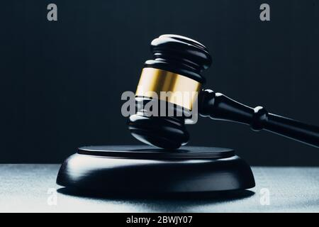 Judge's gavel on a black table. Concept of law