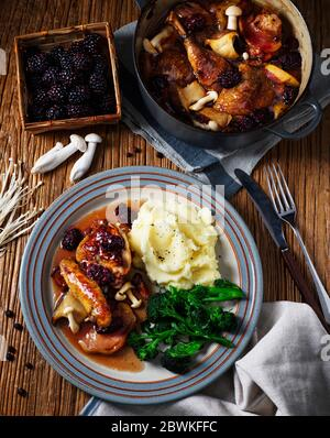 Traditional British Braised Pheasant with Berries and Mushrooms, home cooked meal served with mashed potatoes and tender stem broccoli