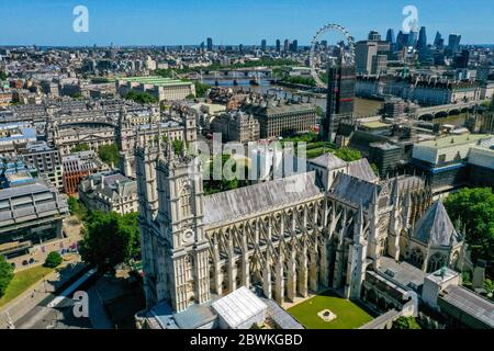 An aerial view of London showing Westminster Abbey (foreground), the London Eye, County Hall, Westminster Bridge, Hungerford Bridge, Waterloo Bridge and Parliament Street. - Stock Photo