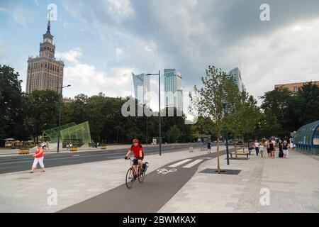 Warsaw, Poland - 2020/06/01: Alone people cycling along the city bike road in downtown. - Stock Photo