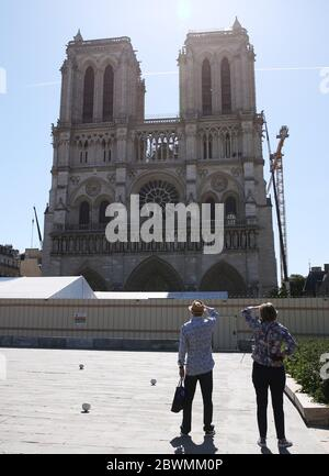 Paris, June 2. 15th Apr, 2019. People visit the open space in front of the Notre-Dame Cathedral in Paris, France, June 2, 2020. The Parvis Notre-Dame was reopened to the public from May 31 after more than one year's close because of the huge fire on April 15, 2019. Credit: Gao Jing/Xinhua/Alamy Live News - Stock Photo