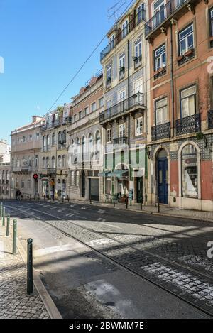 LISBON, PORTUGAL - JULY 4, 2019: Narrow cobblestone streets of the Chiado district in Lisbon, Portugal