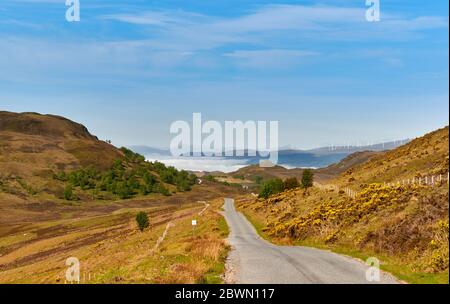 GENERAL WADE'S MILITARY ROAD ON THE SOUTH SIDE OF LOCH NESS SCOTLAND FROM HILL ABOVE LOCH TARFF LOOKING TOWARDS CLOUD INVERSION OVER LOCH NESS - Stock Photo
