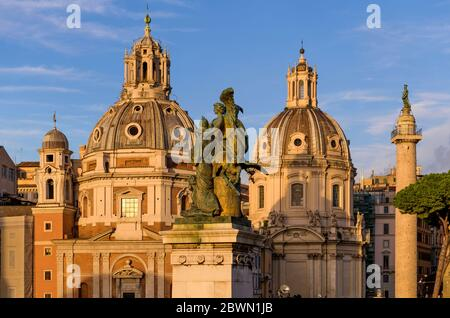 Sunset Rome - Soft evening sunlight shines on domes of the church of Santa Maria di Loreto, left, and The Church of the Most Holy Name of Mary. Italy. Stock Photo