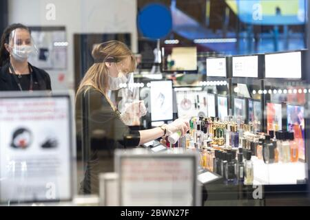 Moscow, Russia. 2nd June, 2020. An employee wearing a face mask and gloves disinfects samples of cosmetics in a shopping center in Moscow, Russia, on June 2, 2020. Russia has confirmed 8,863 new COVID-19 cases to raise its total to 423,741, its coronavirus response center said in a statement Tuesday. Credit: Alexander Zemlianichenko Jr/Xinhua/Alamy Live News