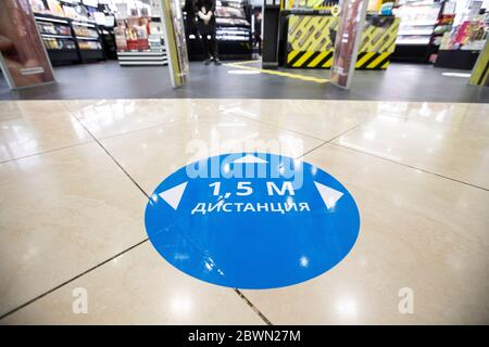 Moscow, Russia. 2nd June, 2020. A social distancing sign is seen on a floor in a shopping center in Moscow, Russia, on June 2, 2020. Russia has confirmed 8,863 new COVID-19 cases to raise its total to 423,741, its coronavirus response center said in a statement Tuesday. Credit: Alexander Zemlianichenko Jr/Xinhua/Alamy Live News
