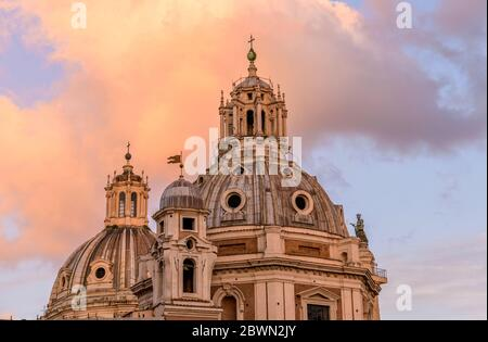 Sunset Dome - Close-up sunset view of the domes of the church of Santa Maria di Loreto and the Most Holy Name of Mary at the Trajan Forum. Rome, Italy. Stock Photo