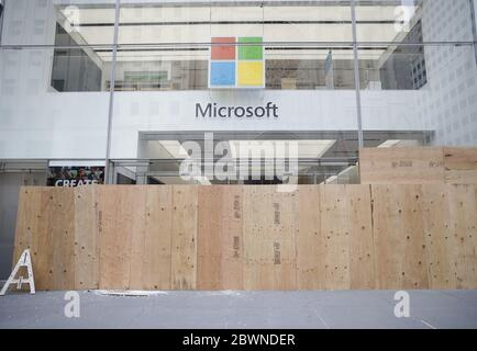 A Microsoft retail store on Fifth Avenue is boarded up after a long night of unrest in Manhattan as protests, looting and rioting around the country continue over the death of George Floyd at the hands of the Minneapolis police in New York City on Tuesday, June 2, 2020. Former Minneapolis police officer Derek Chauvin was arrested Friday days after video circulated of him holding his knee to George Floyd's neck for more than eight minutes before Floyd died. All four officers involved in the incident also have been fired from the Minneapolis Police Department. Photo by John Angelillo/UPI - Stock Photo
