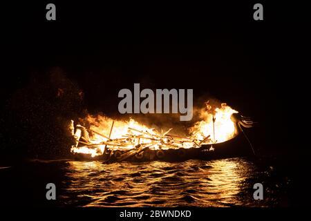 Viking longship burning at Up Helly AA Shetland - Stock Photo