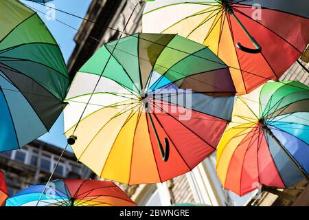 Background colorful rainbow different color umbrellas. unban tourist street decoration. - Stock Photo
