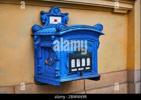 Berlin, Germany - May 13, 2020: Details of a historical letter box from the old Prussia in Berlin, Germany, which is still used for letter delivery to - Stock Photo