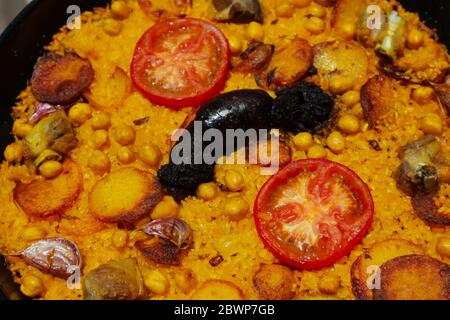 Close-up of a cooked baked rice casserole, typical dish from Valencia, Spain. - Stock Photo