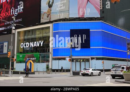 Windows of Old Navy and Gap stores in Times Square boarded up after another night of vandalism and looters who are using the protests over the death of George Floyd as an opportunity to cause chaos. Manhattan, New York City, USA June 2, 2020 - Stock Photo